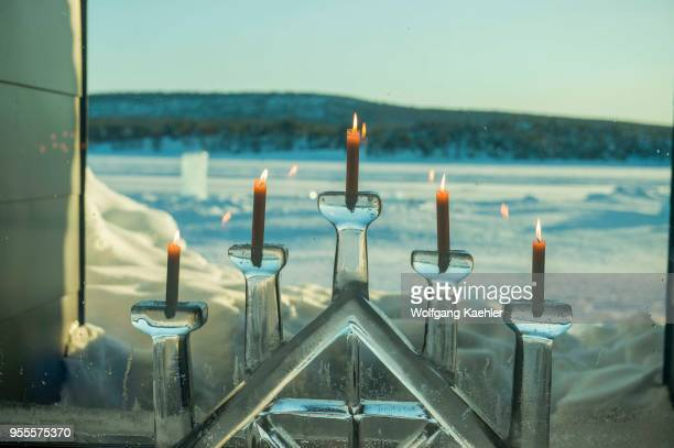 A window with candles in an ice candle holder at the ICEHOTEL 365 which was launched in 2016 and is a permanent structure offering year round the...