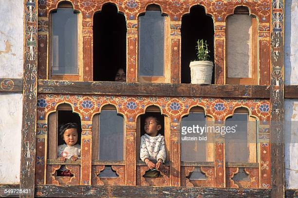Window with children in Paro BTN Bhutan