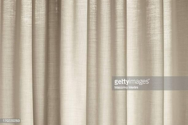 window with drapes covering it - beige stockfoto's en -beelden
