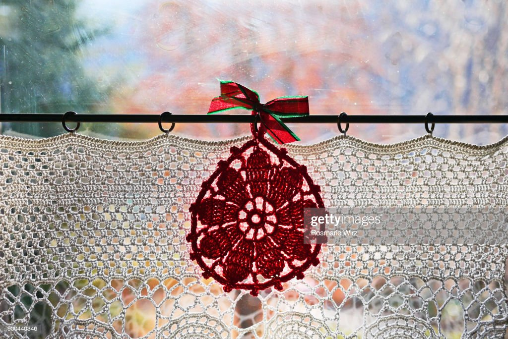 Window with hand-made lace curtain : Stock Photo