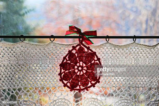 window with hand-made lace curtain - crochet stock pictures, royalty-free photos & images