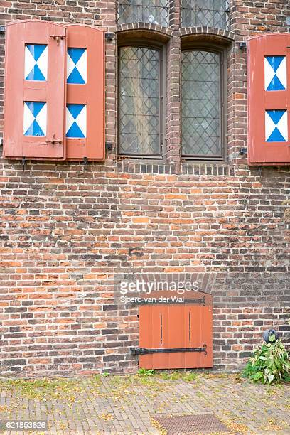 window with shutters in the zwolle colors blue and white - zwolle stock photos and pictures