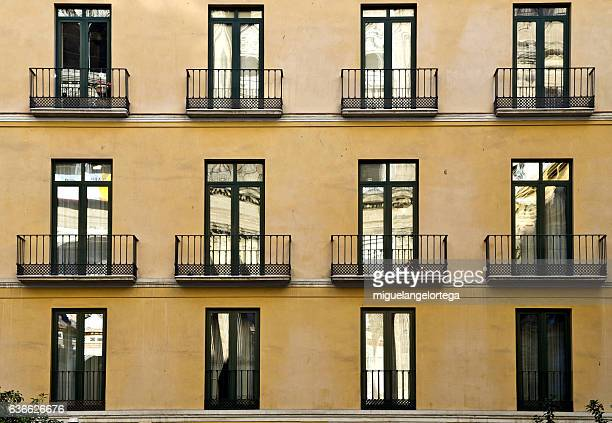 windows and balconies - simetria stock photos and pictures