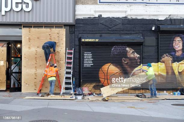 Windows and doors of a shop are boarded up in the Brooklyn borough on U.S. Election day on November 3, 2020 in New York, United States.