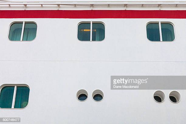 Windows and portholes of a moored cruise ship