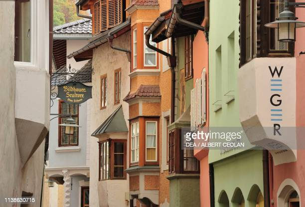 Windows and signs in a street in the centre of Klausen, Eisack Valley, Trentino-Alto Adige, Italy.