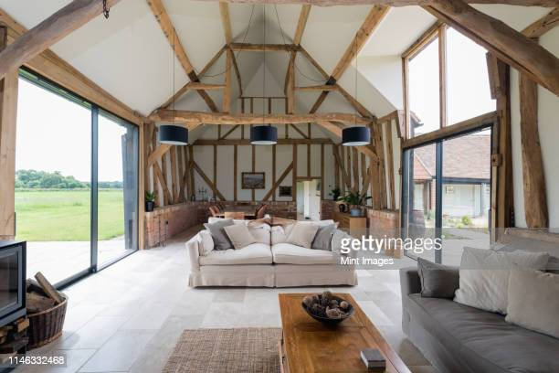windows and sofa in modern living room - oxford england stock pictures, royalty-free photos & images