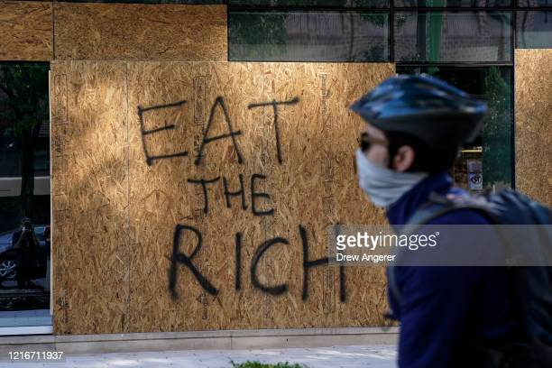 Windows are boarded up on a BBT bank building that was vandalized during overnight unrest June 1 2020 in Washington DC Protests and riots continue...