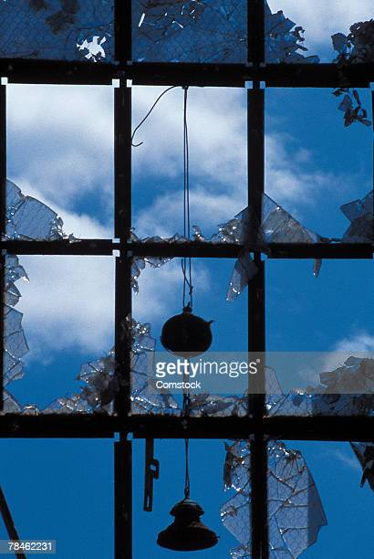 Windows being smashed by wrecking ball