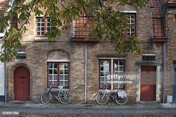 windows, doors and bicycles - simetria stock photos and pictures