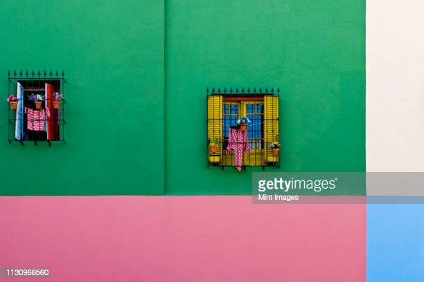 windows in colorful building exterior - buenos aires stock pictures, royalty-free photos & images