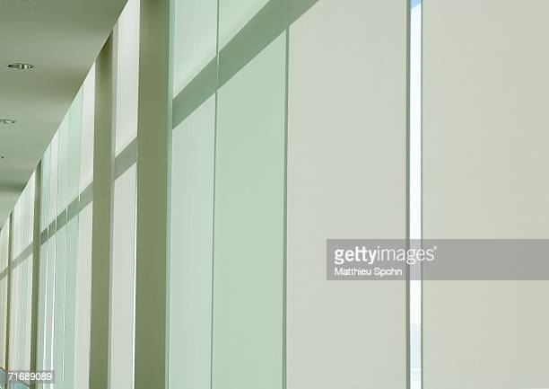 Windows in office building with shades lowered