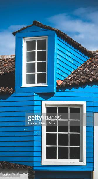 Windows of an old blue house in the Azores