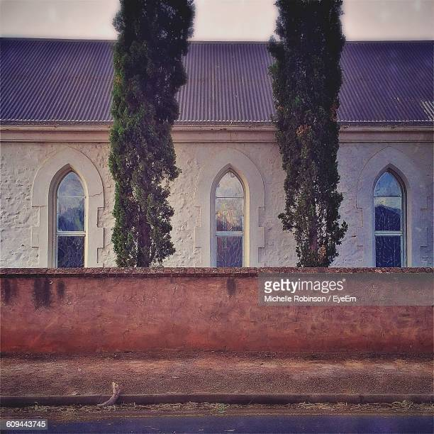 windows of church by street - catholicism stock pictures, royalty-free photos & images