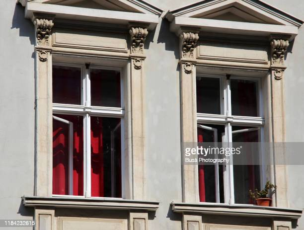 windows of traditional residential building in berlin, germany - neo classical stock pictures, royalty-free photos & images