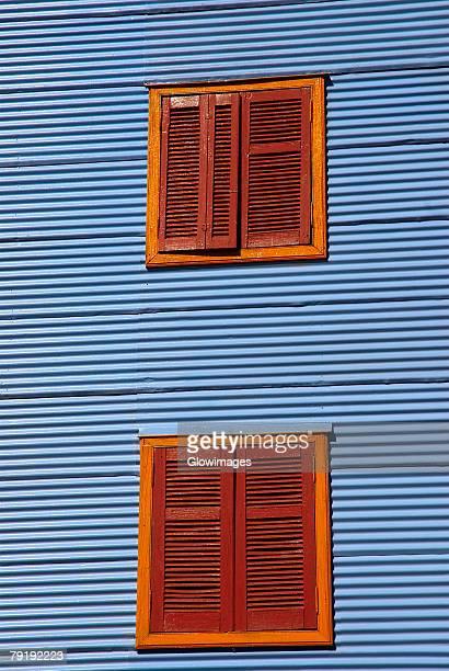 Windows on the wall of a building, Caminito, La Boca, Buenos Aires, Argentina