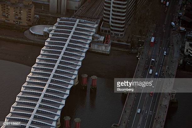 Windows sit in the roof of London Blackfriars passenger train station left as road traffic passes over Blackfriars Bridge in this aerial photograph...