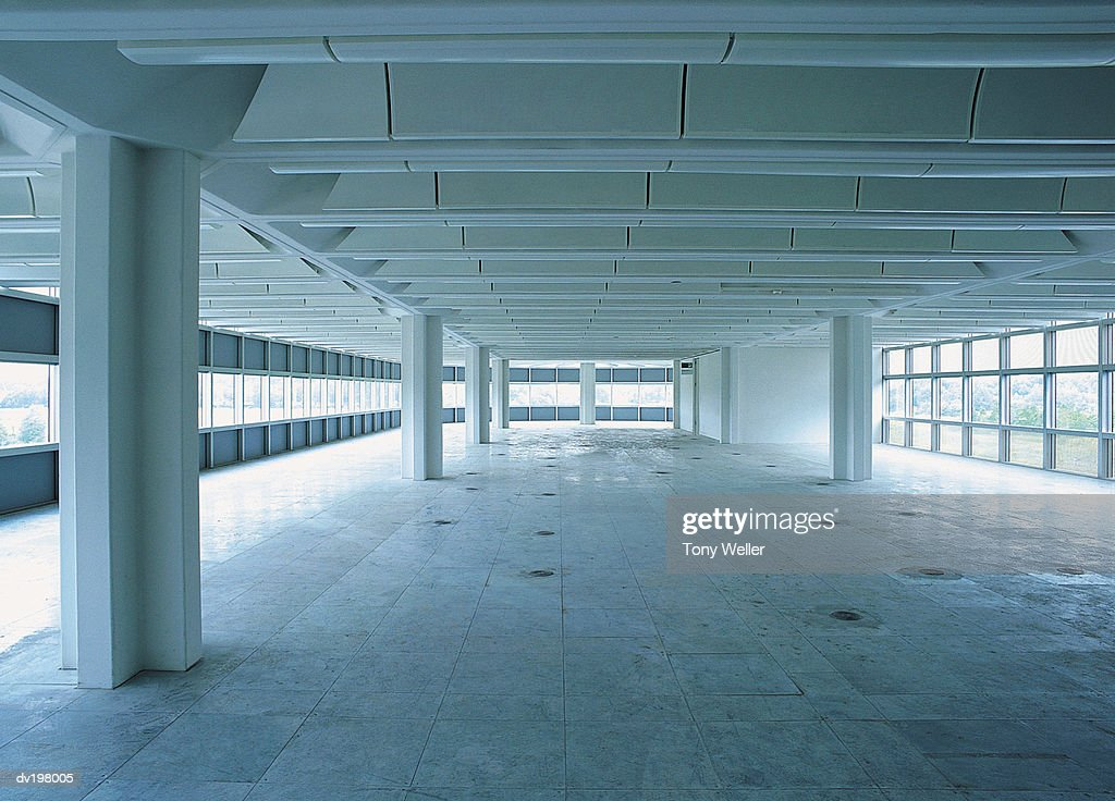 Windows surrounding empty interior : Stock Photo