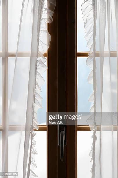 Windows with sheer curtain