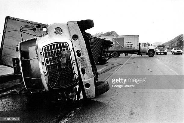 JAN 15 1981 JAN 14 1982 JAN 15 1982 Winds blew over two trucks on Interstate 70 near its cut through the foothills west of Denver Witnesses said...