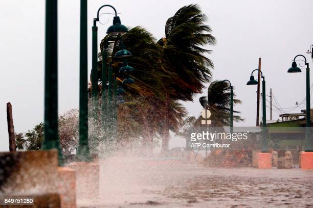 TOPSHOT Winds lash the coastal city of Fajardo as Hurricane Maria approaches Puerto Rico on September 19 2017 Maria headed towards the Virgin Islands...