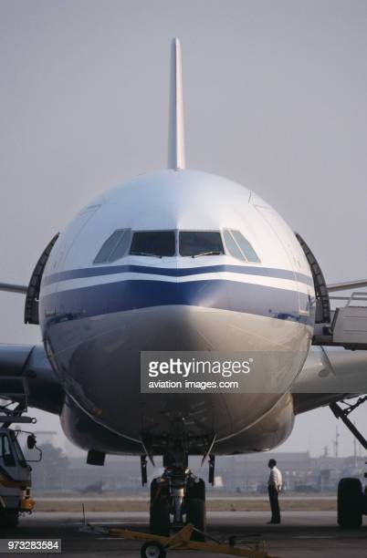windshield nosewheel undercarriage and open doors of an Air China Interntaional Airbus A340300 parked