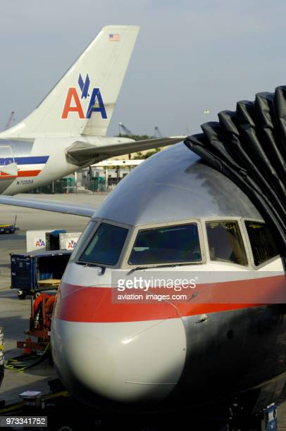 windshield of an American Airlines Boeing 757200 with tail of an Airbus A300600 parked behind