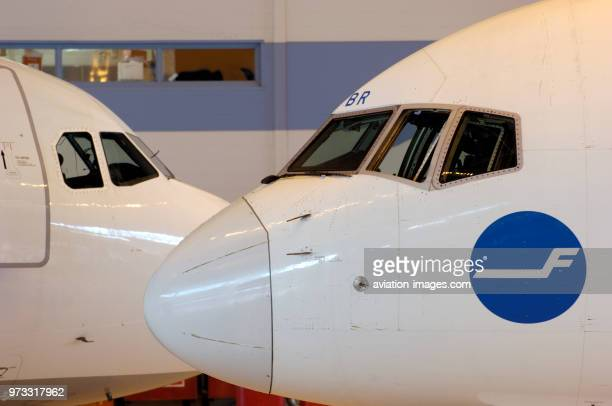 windshields of a Boeing 757200 and Airbus A321200 in hangar Leko 7 at Finnair Technical Services