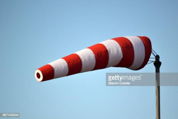 windsock on blue sky - wind stockfoto's en -beelden
