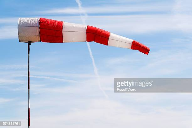Windsock, red and white stripes, blue sky