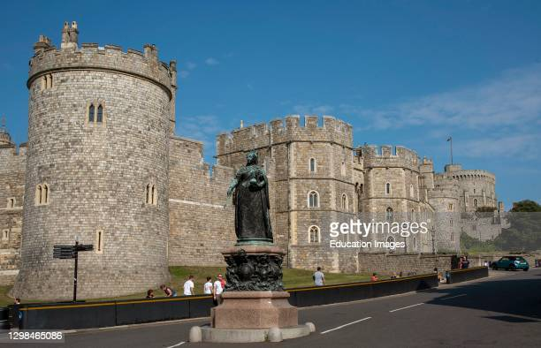 Windsor, Berkshire, England, UK, Castle Hill and Windsor Castle with black security barrier on the curbside.