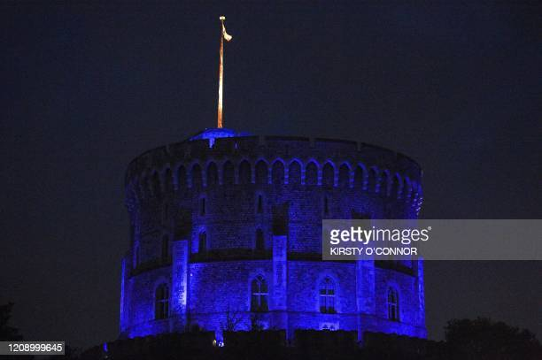 Windsor Castle is lit blue during a countrywide salute to local heroes and to show thanks for the work of Britain's National Health Service workers...