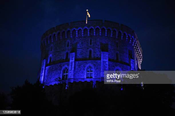 Windsor Castle is turned blue to salute local heroes during Thursday's nationwide Clap for Carers NHS initiative to applaud NHS workers fighting the...