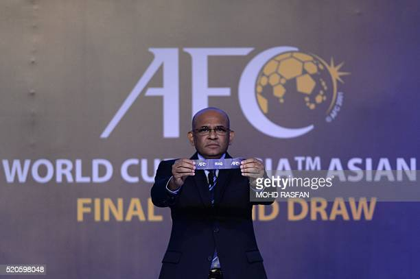 Windsor John Asian Football Confederation General Secretary displays a draw for Iraq during the official draw for the final round of the 2018 World...