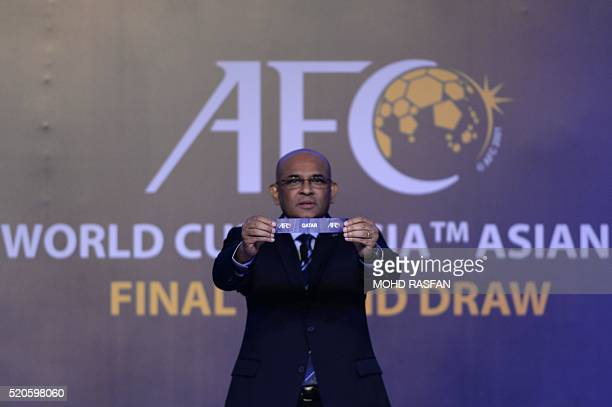 Windsor John Asian Football Confederation General Secretary displays a draw for Qatar during the official draw for the final round of the 2018 World...