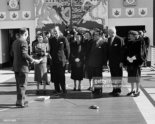 Windsor Mayor Arthur J Reaume presents a miniature battery operated car symbol of the automobile industry to Their Royal Highnesses the Princess...
