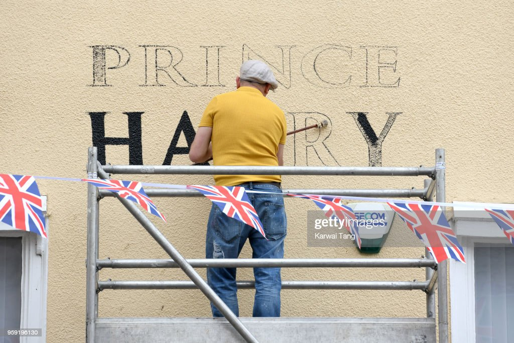 A Windsor public house has been renamed 'The Prince Harry' for the week prior to the wedding of Prince Harry and Meghan Markle, here an artist paints the new name on May 16, 2018 in Windsor, England.