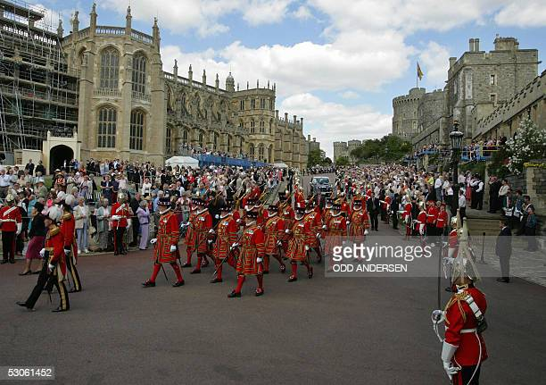Windsor, UNITED KINGDOM: Yeomen warders march during the Garter service at the St George's chapel at Windsor castle, 13 June 2005. Windsor Castle...