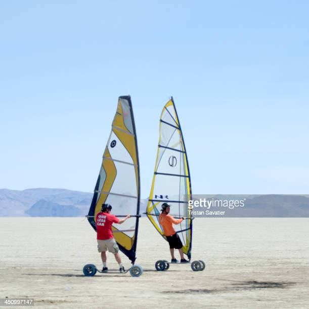 Windsurf Landsailing on the alkaline flat dry lake in the Black Rock Desert . Speedsailing is a popular sport in Europe, where is it performed on the...