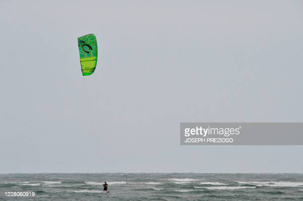 Windsurfer enjoys the waves and 20MPH wind at Wingaersheek Beach in Gloucester Massachusetts on August 15 2020 Over the past summer weekends hundreds...