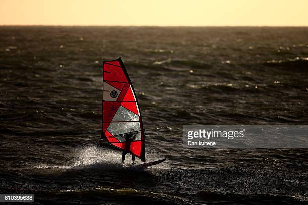 A windsurfer in action on the water in the English Channel off the coast of Brighton Hove on September 25 2016 in Brighton England