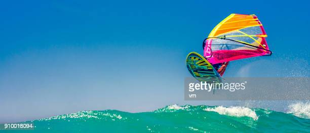 windsurfer in mid-air - windsurfing stock pictures, royalty-free photos & images