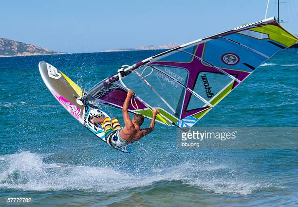 windsurfer in sardegna (italy) - windsurfing stock pictures, royalty-free photos & images