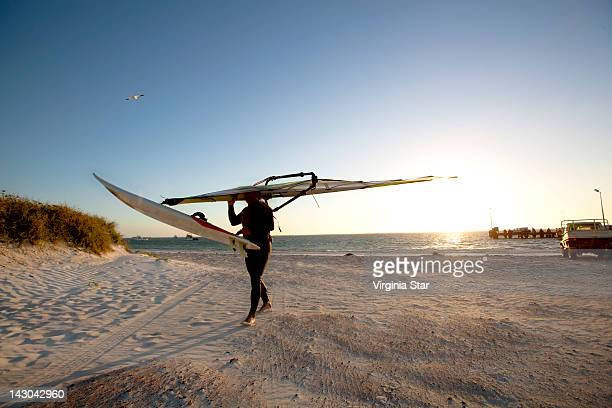windsurfer in wetsuit - windsurfing stock pictures, royalty-free photos & images
