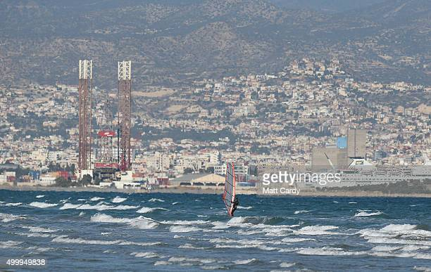 Windsurfer is seen in front of Limassol viewed from the beach at Akrotiri on December 4, 2015 in Akrotiri, Cyprus. Yesterday the RAF sent two further...