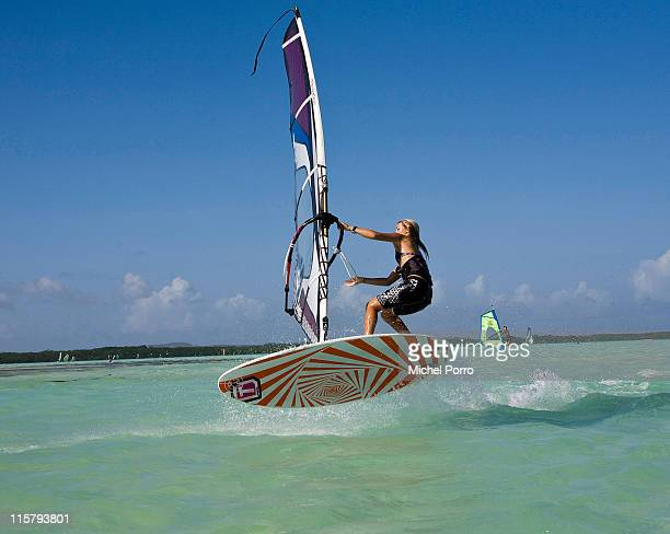 A windsurfer makes a freestyle move on Lac Bay on February 7 2011 on Bonaire Netherlands Antilles Windsurfers jump make loops and perform spinning...