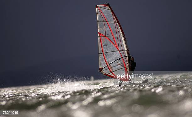 A windsurfer makes the most of the high winds and swell on Lake Ammersee January 19 near Stegen Germany The storm sytem 'Kyrill' pounded Germany...