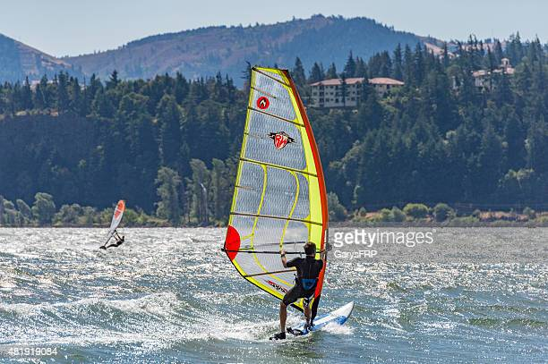 windsurfer on columbia river with columbia gorge hotel background - hood river stock pictures, royalty-free photos & images