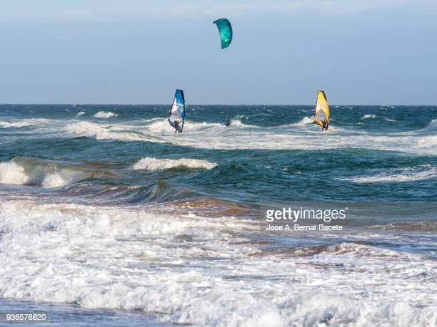 Windsurfers and Kiteboarding in Calblanque, Murcia, Spain.