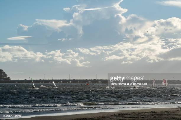 Windsurfers enjoying on the sunset beach in Shonan in Japan